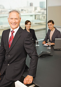 Smiling Business People In Conference Room